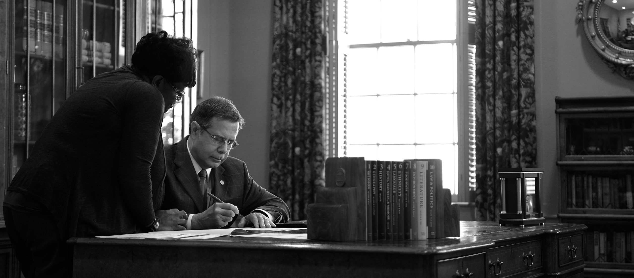 This is a photo of Chancellor Vitter signing a document.