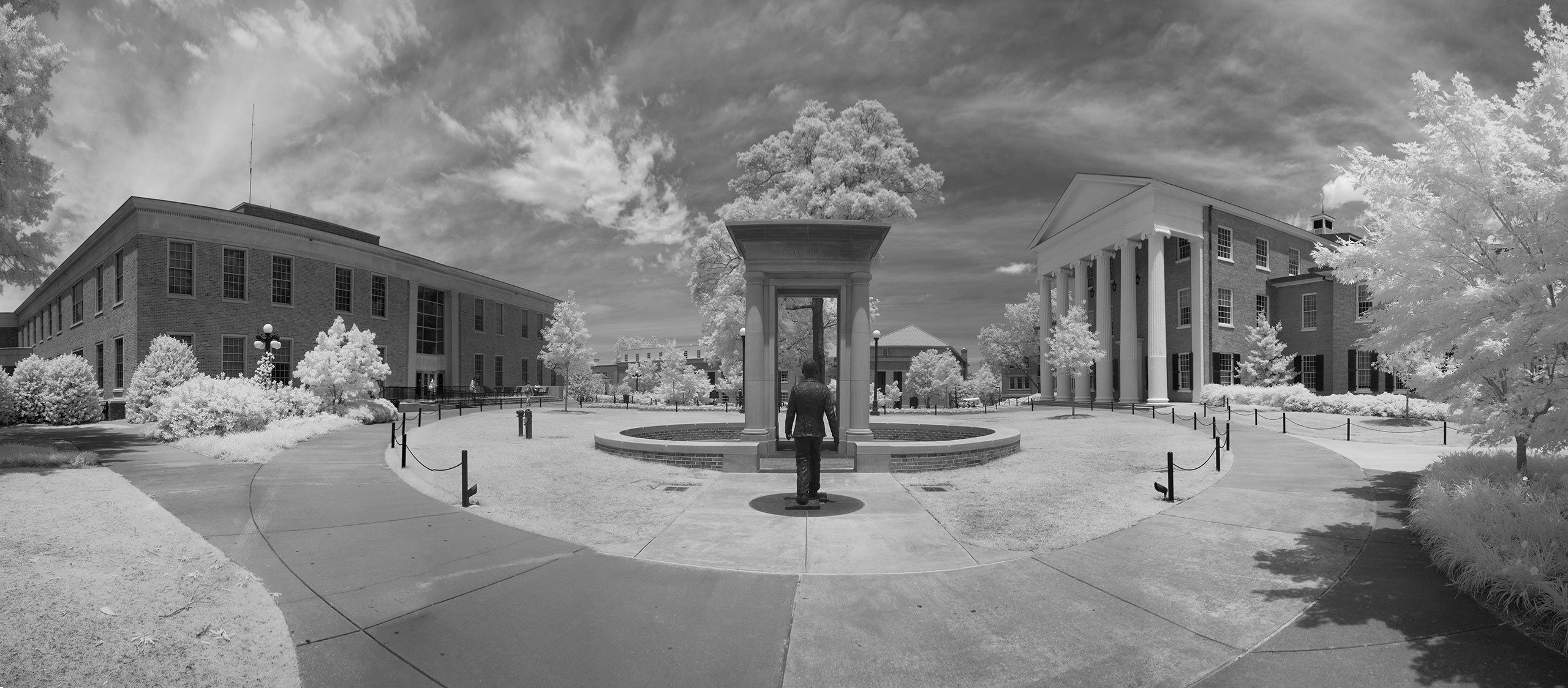 This is a photo of a monument on campus and the Lyceum in the background.