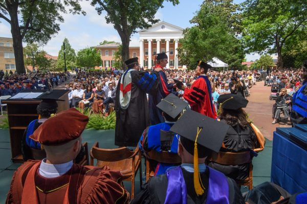 Graduates outside with Lyceum in background
