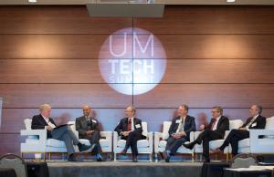 Six Tech Summit speakers on stage
