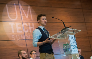 Student speaker at clear podium
