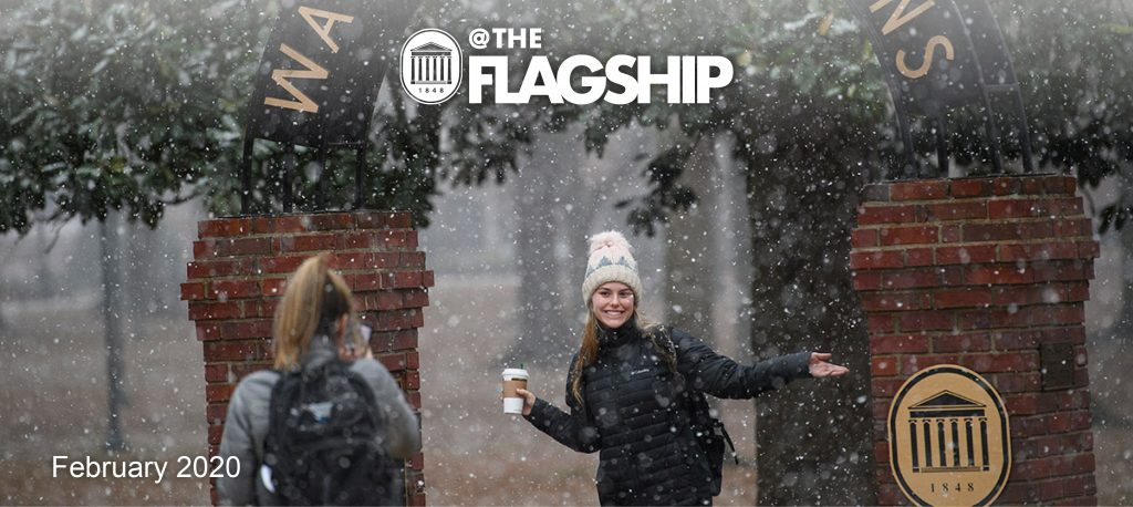 UM Crest, @ The Flagship, February 2020, Girl in snow at the walk of champions drinking coffee.