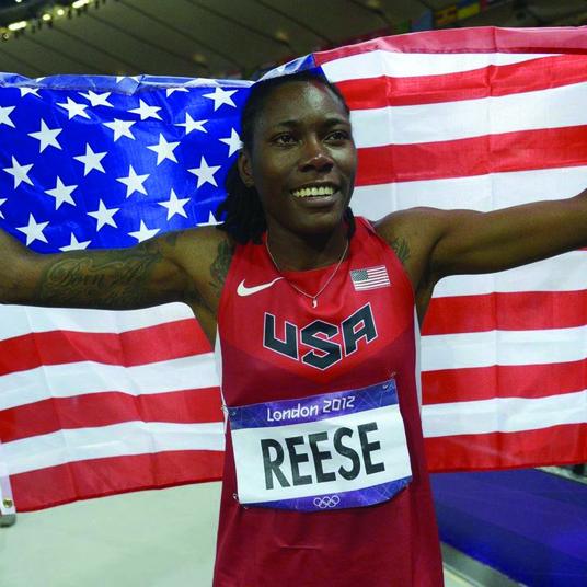 American flag being held by athlete
