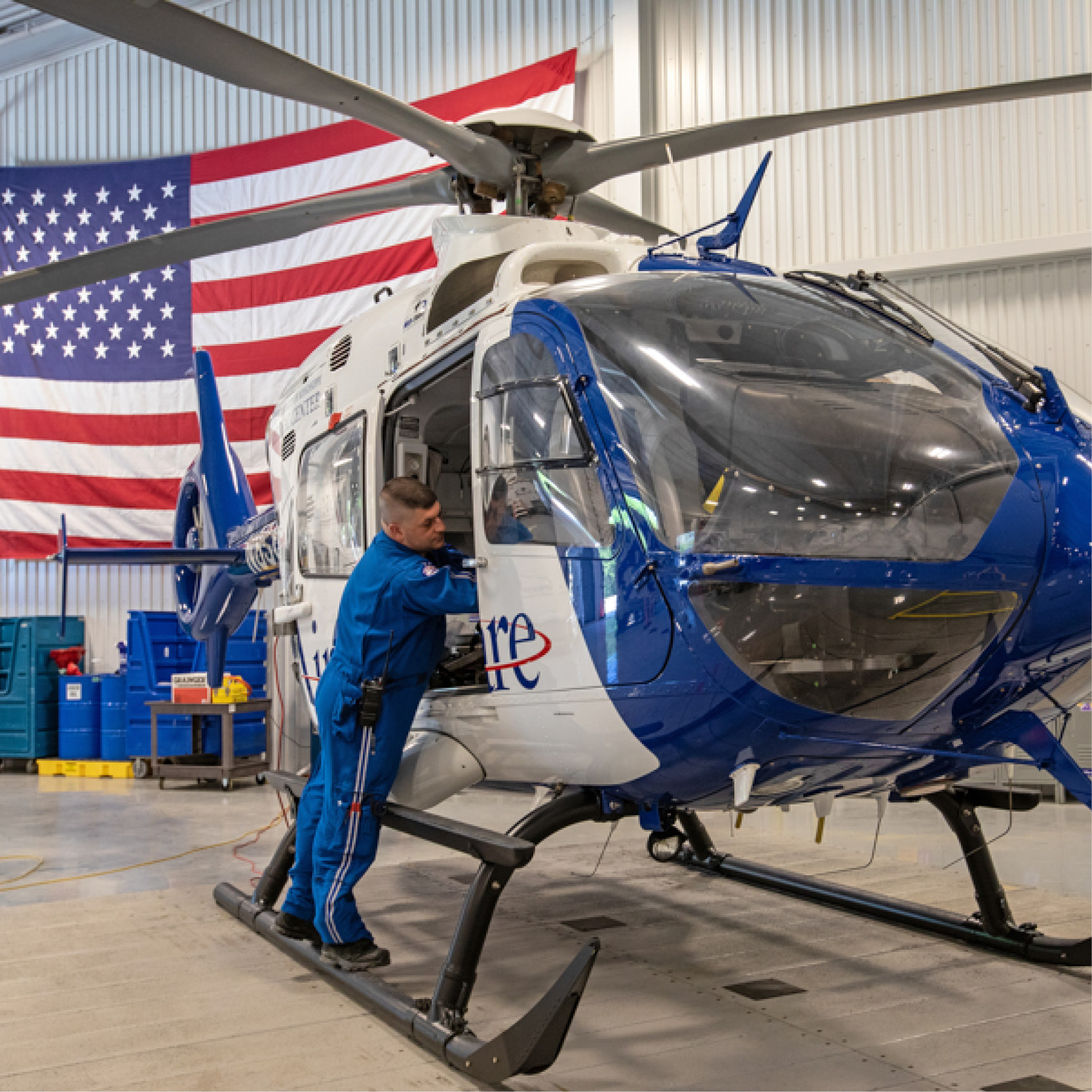 Helicopter with American flag in background