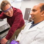UM pharmacology professor Joshua Sharp (left) works with associate research scientist Sandeep Misra in a lab in the Department of BioMolecular Sciences