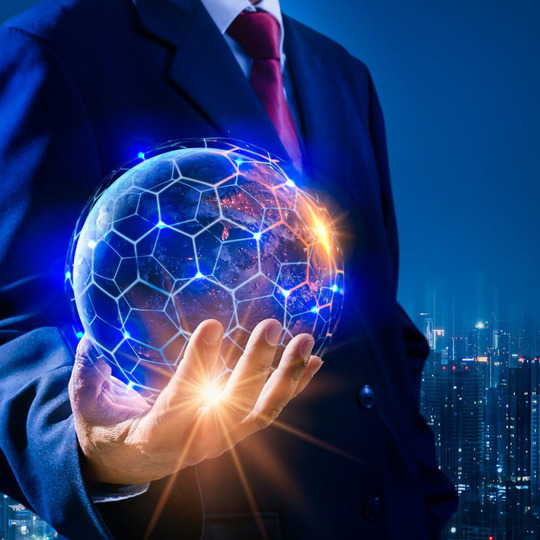 Person in suit holding tech glowing ball