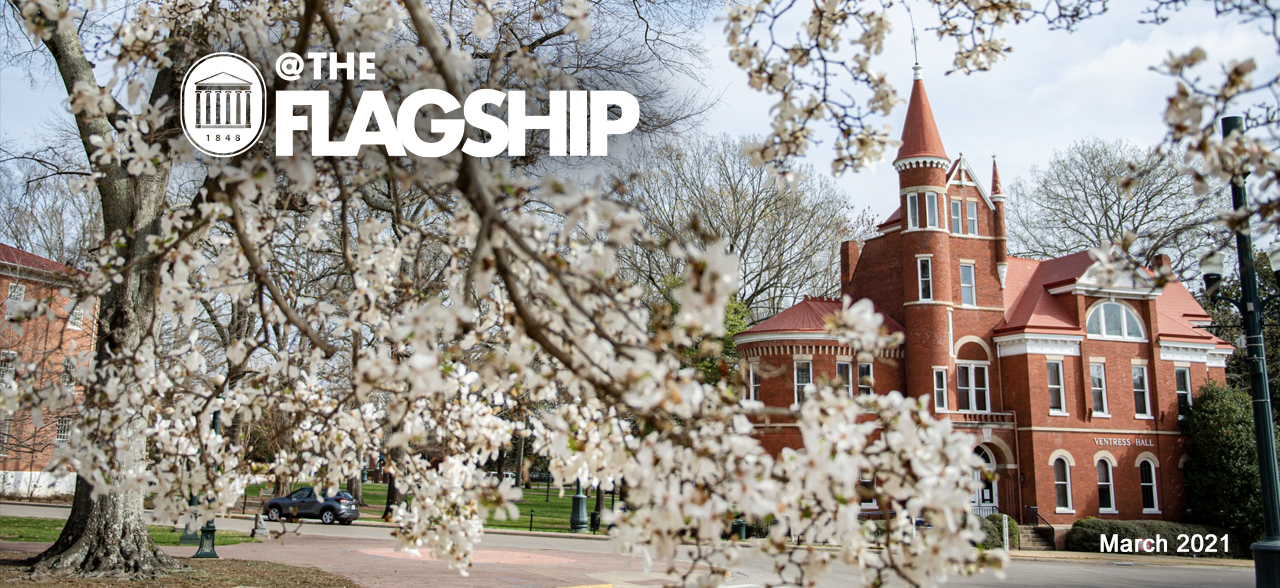 UM Crest, @The Flagship, March 2021, beautiful shot of blooming pear trees with Ventress Hall in the background.