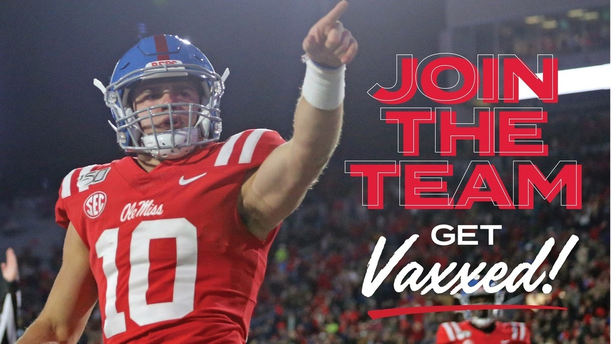 Football player pointing, text says Join the team, Get vaxxed
